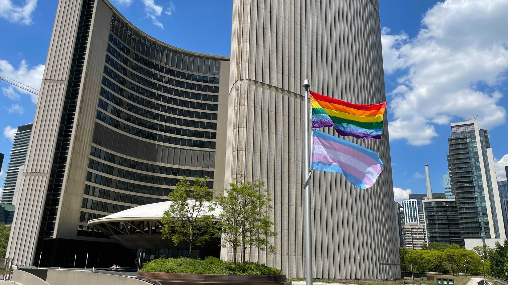 A picture of the City of Toronto Rainbow and Transgender Flag-Raising Ceremony 2021