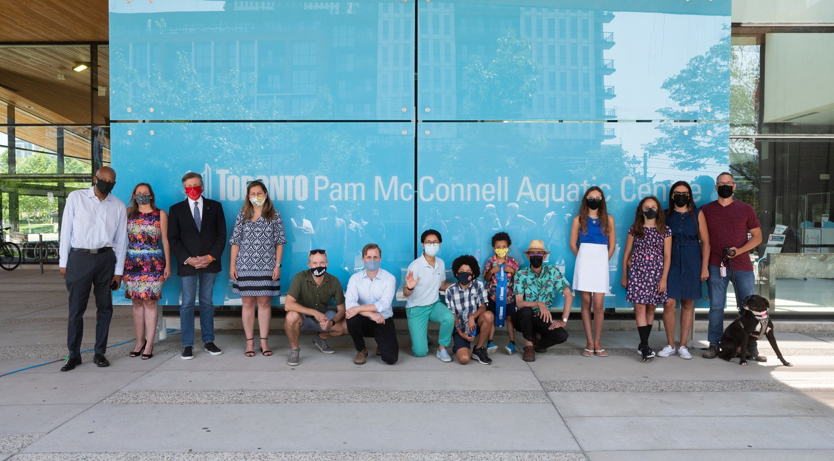 Unveiling a new sign for the renamed Pam McConnell Aquatic Centre in Regent Park, a picture with attendees