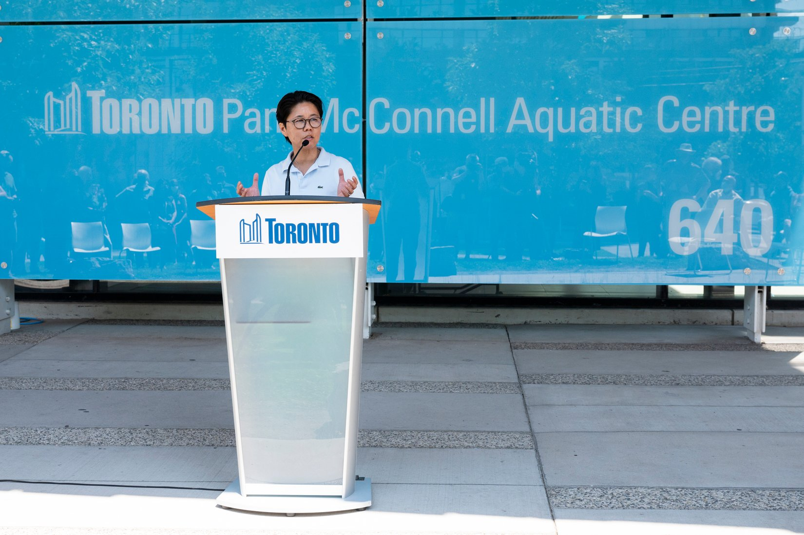 A picture of Councillor Wong-Tam speaking at the unveiling of a new sign for the renamed Pam McConnell Aquatic Centre in Regent Park