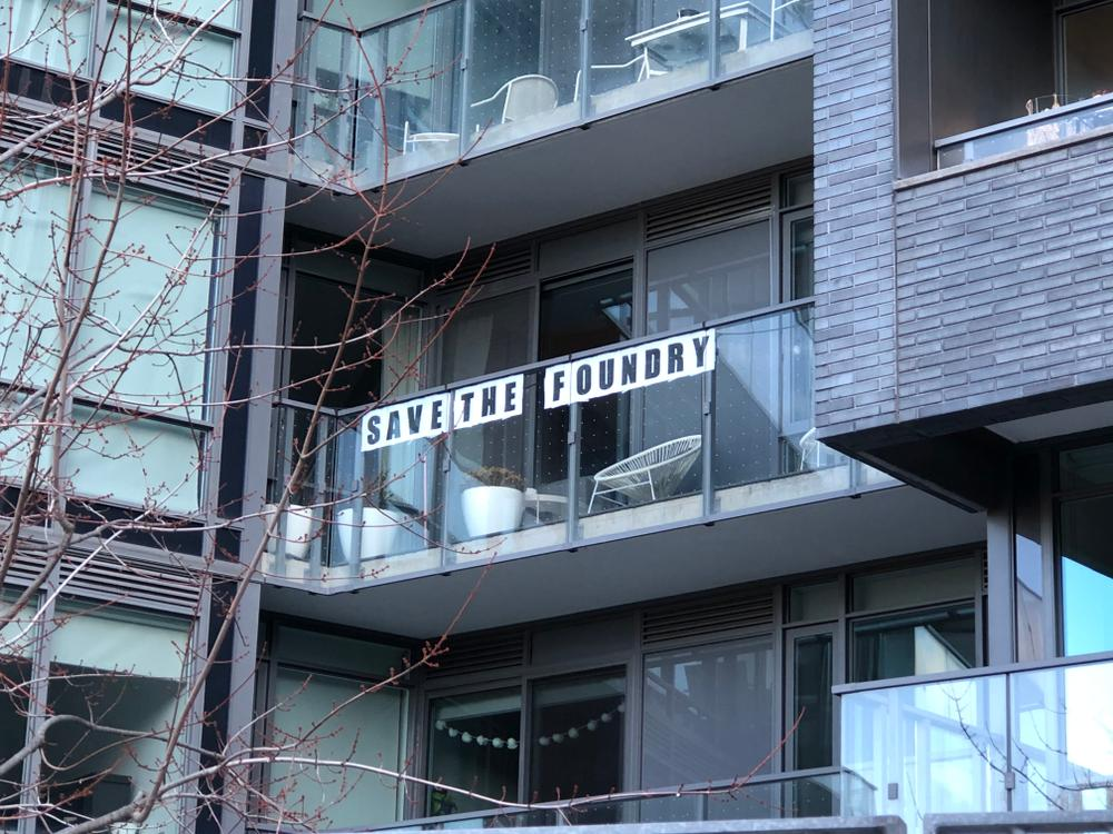 Signs started appearing on neighbouring balconies
