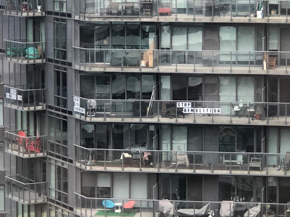 Protest signs on neighbouring balconies, January 24