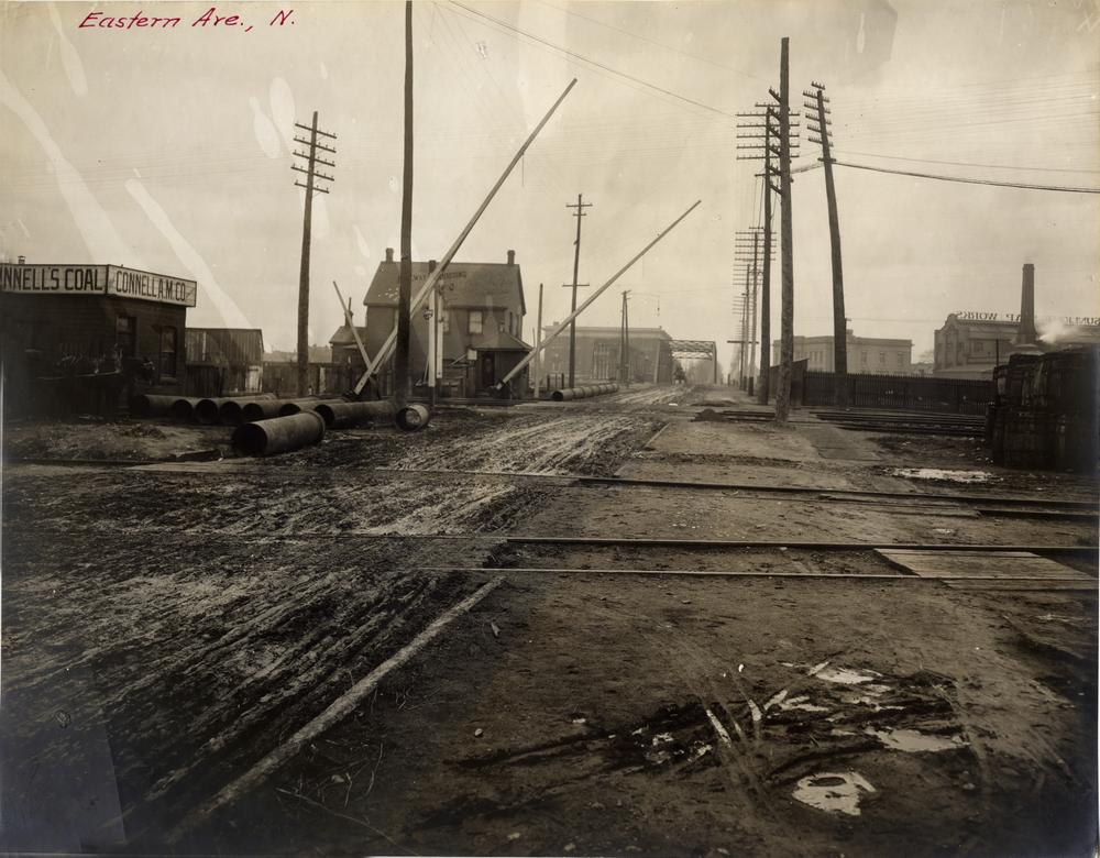 Eastern Avenue, early 1900s, looking east across railway tracks to bridge over Don River. The photographer is standing near what is now the northeast corner of the site. You can see the bridge across the Don, still standing but no longer in use today.