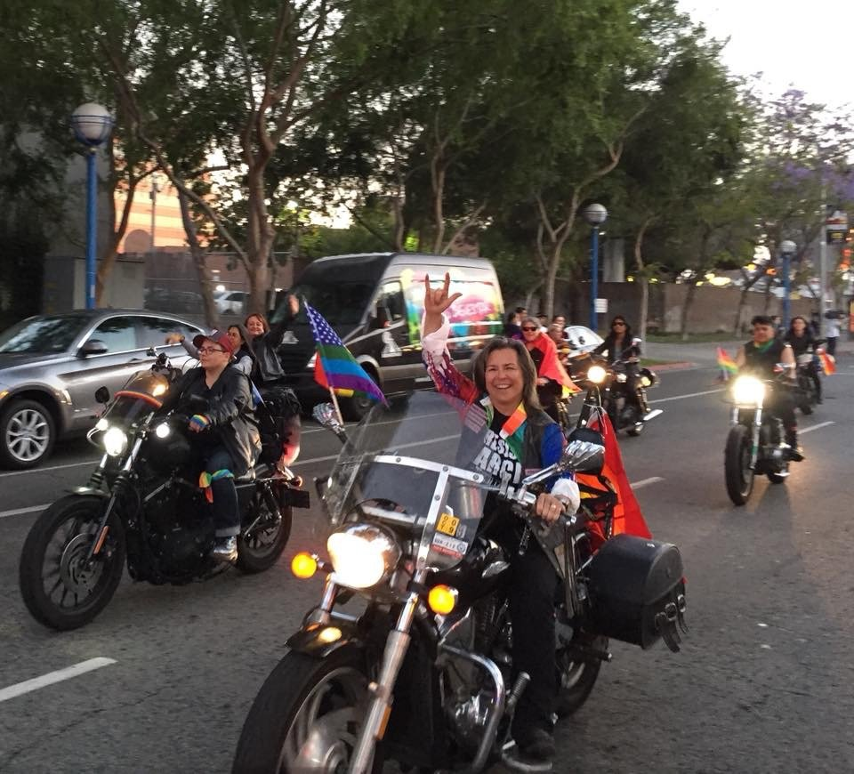 Lesbian activist and motorcycle enthusiast Marna Deitch rides through West Hollywood with Dykes on Bikes